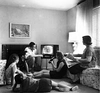 Typical American family from the 50s in front of television set