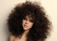 Como reduzir o volume do cabelo