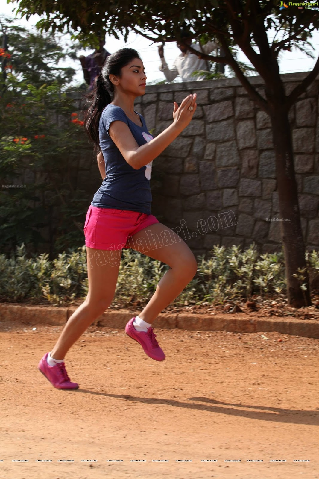 Shriya Saran Doing Yoga in Tight Track Suit And Sleeveless Top