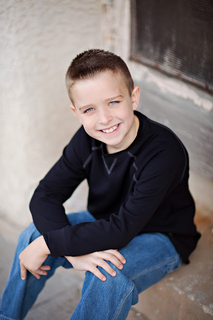 Sahuarita child poses for head shot during family photo session