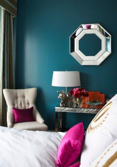 teal and white bedroom with bright accents