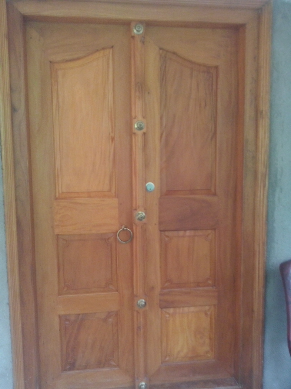 Kerala style carpenter works and designs front entrance for Main two door designs