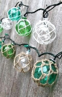 Coastal lamps inspired by fishing glass floats for Fish string lights