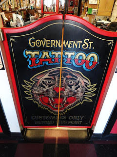 Government street Tattoo Studio swinging door signage Victoria British Columbia North America traditional signage dobell designs