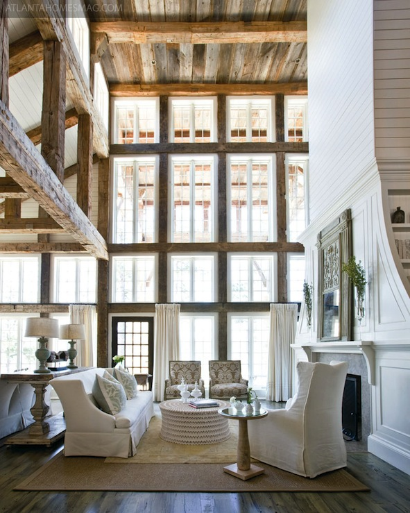 Beautiful light living and dining room with wooden beams for Natural wood beams