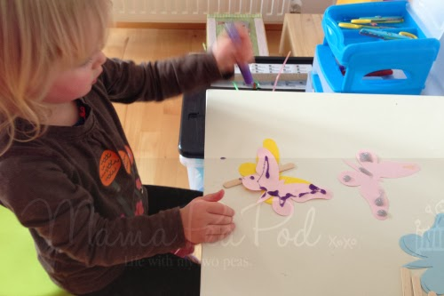 preschooler making butterfly puppet