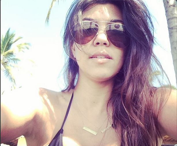 Kourtney Kardashian wears a Love You necklace