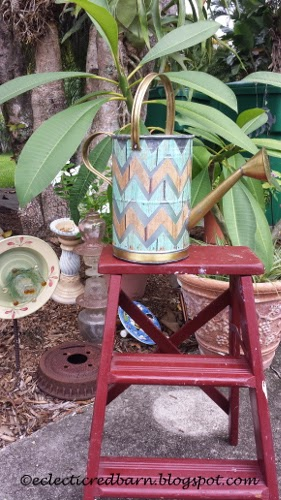 Eclectic Red Barn: Watering Can with of chevron  on red ladder
