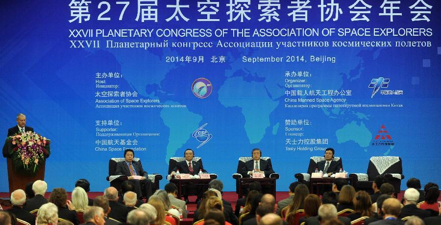A total of 93 astronauts from 18 countries, including China, the United States and Russia, gathered in Beijing on September 10, 2014 for the 27th Planetary Congress of the Association of Space Explorers (ASE). [Photo from Xinhua]