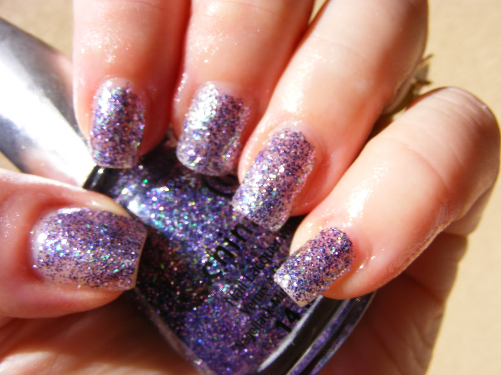 This Polish Is A Complex Collection Of Purple Glitter In Two Diffe Sizes Micro And Super Even The Bar Which Flashes From Teal Green To