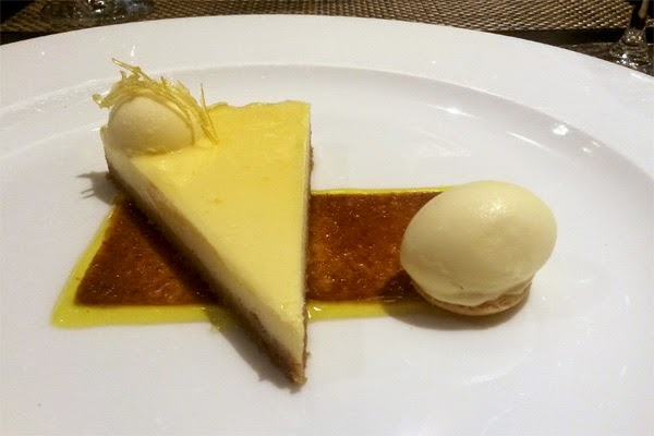 Zesty lemon cheese cake with ginger ice cream.
