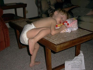funny picture: child asleep on the table