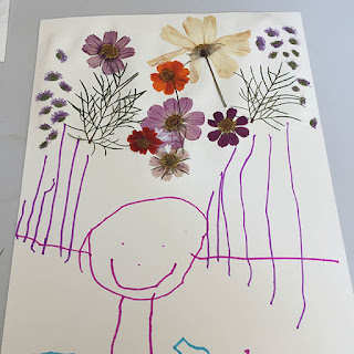 Tickled by the Creative Bug - Gluing pressed flowers to a child's drawing