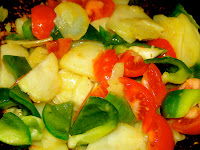 Stir fried porato, green pepper and tomato