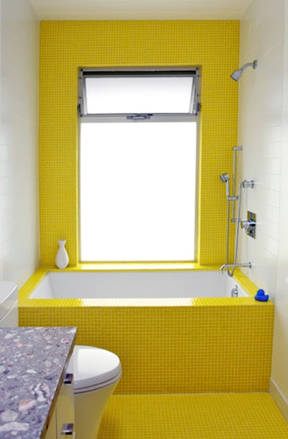 yellow tile bathtub with blue rubber ducky