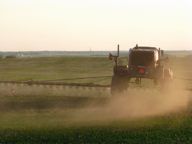 Picture of tractor spraying crops in a field