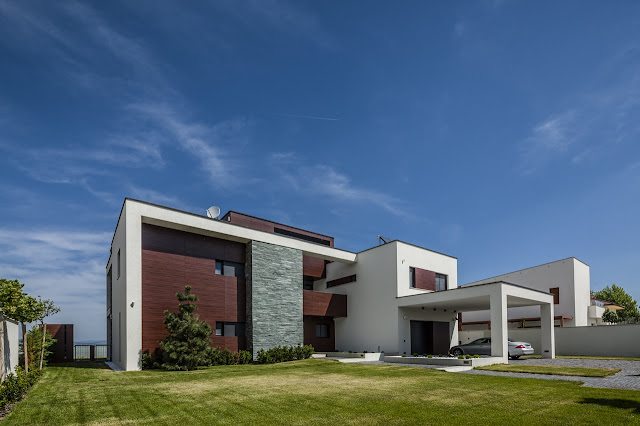 Modern home with large lawn in front of it
