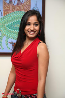 Madhavi Latha  Pictures in Red Sleeveless Top and Jeans at Muse Art Gallery  0012.jpg