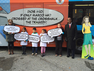 Mr. Leggett poses in front of new pedestrian safety ad with children from New Hampshire Estates Elementary School
