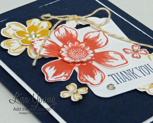 Stampin' Up! Beautiful Bunch stamp set and Flower Shop stamp set. Uses coordinating punches plus scalloped tag topper punch. A floral card in navy, coral, and yellow.