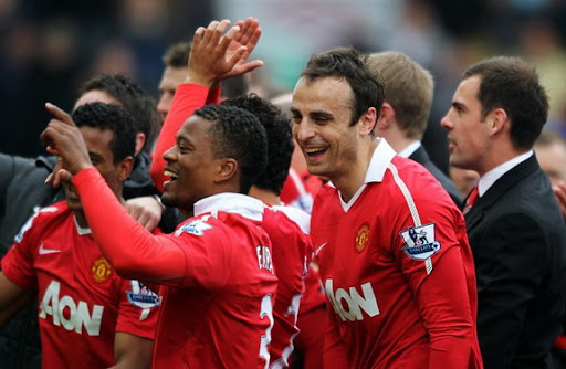 Patrice Evra celebrates with Manchester United team-mates after winning the Premier League title