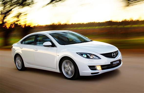 Front 3/4 view of 2012 Mazda 6 being driven on country road