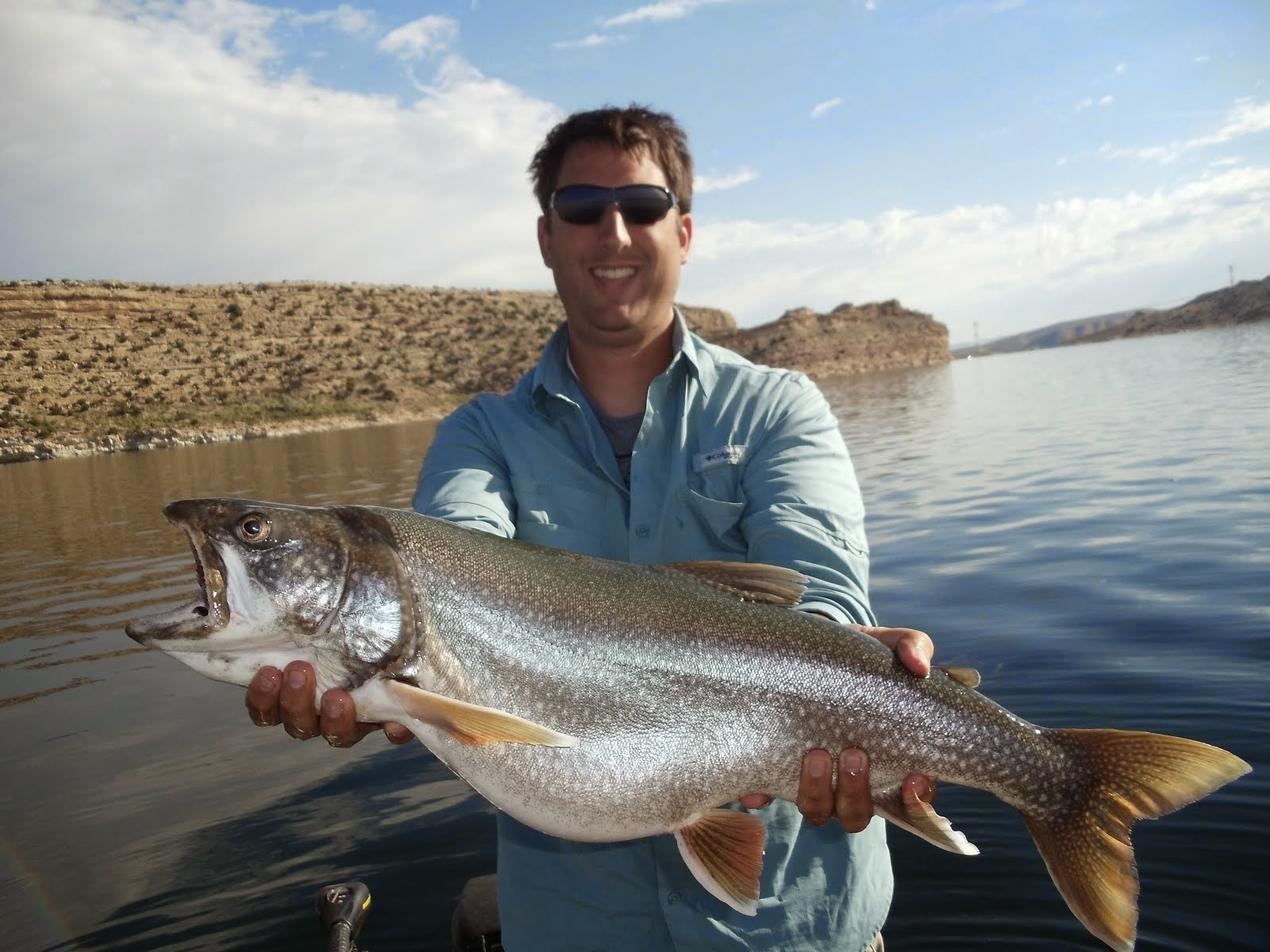 Utah fisherman silver lake flat reservoir 20 lb flaming gorge lake trout publicscrutiny Images