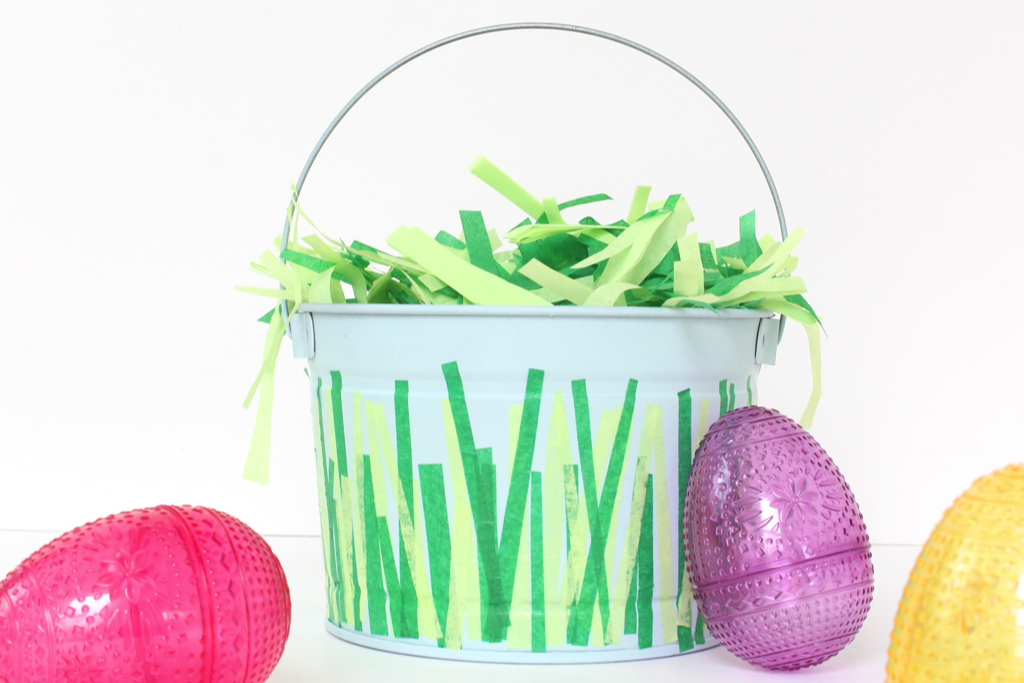 Take a cheap bucket, spray paint it, and add tissue paper - yes please!