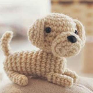 http://translate.google.es/translate?hl=es&sl=en&tl=es&u=http%3A%2F%2Fwww.womansday.com%2Fhome%2Fcraft-ideas%2Fcraft-project-crochet-dog-119738