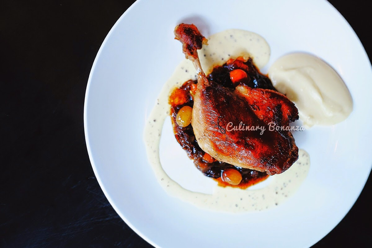 Duck Leg Confit - sous vide duck leg in duck fat, grapes & tomato concasse, mash potato
