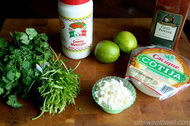 Mexican Street Corn - Elote Ingredients: Cilantro, Crema Mexicana, Two Limes, Cotija Cheese and Chili Powder.