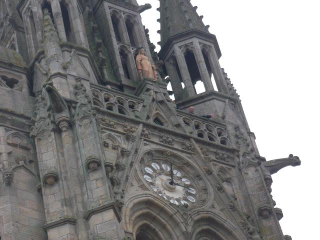 Basilica de Notre Dame du Roncier Josselin's church bell tower and clock