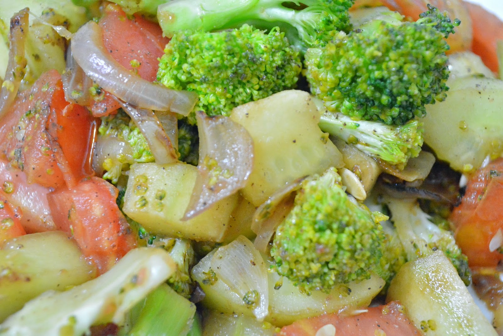 Broccoli salad with cucumber, tomato, onions, salt and pepper powder