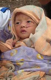 an Indonesian baby being orphaned after the 2004 tsunami