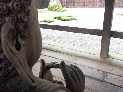Buddha in a Japanese garden