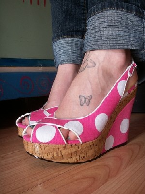 girly tattoos on feet