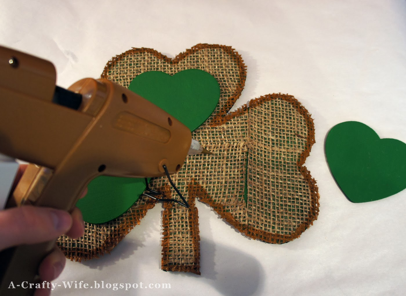 Hot glue painted wooden hearts onto cardboard shamrock | A Crafty Wife
