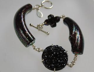 Black bracelet, dichroic glass, vintage cabochon, Swarovski crystals.