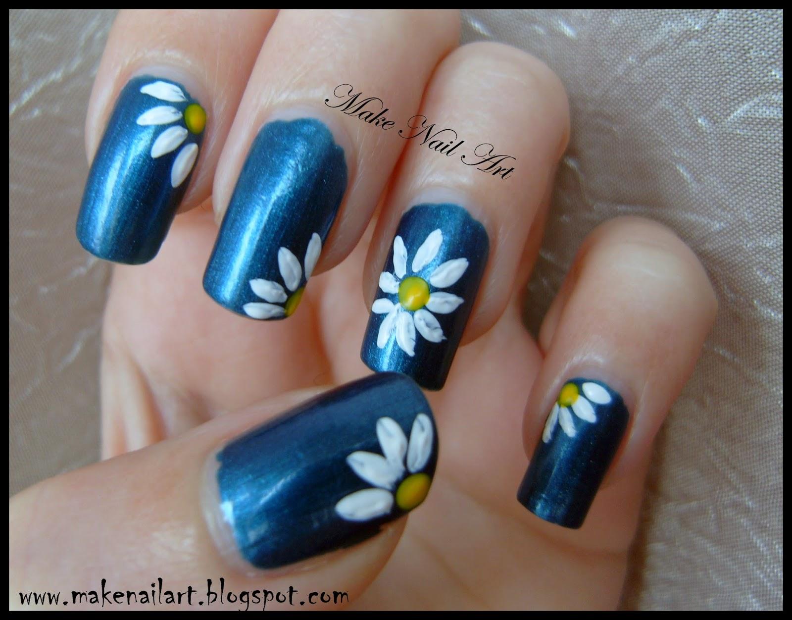 White Daisy Nail Design: Daisy floral nail art.
