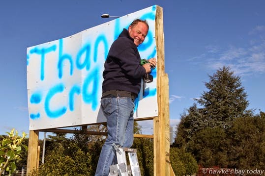 Craig Foss, re-elected National MP for Tukituki electorate, recycles his election billboards just two days after having taken them all down, thanking his voters grafitti-style, in Havelock Rd, Havelock North. photograph