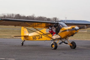 Santa Claus flies into Solberg-Hunterdon Airport in Readington Twp., New Jersey