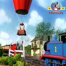 Percy Thomas tank engine James and the red balloon waiting at a the train railway crossing in Sodor