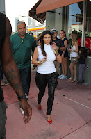 Kim Kardashian in front of  a Motorcycle Store in Miami Beach
