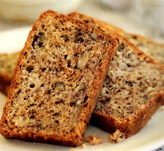 Slices of banana and pecan nut cake arranged on a serving plate