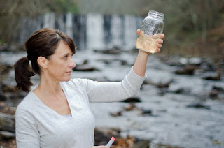 Woman checks water sample.