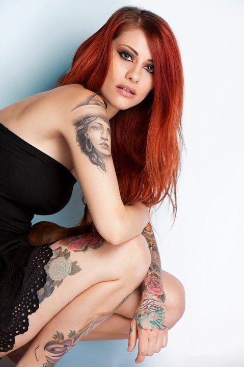 lot of tattoos on his body.she has cool body tattoos.she is hot tattoo