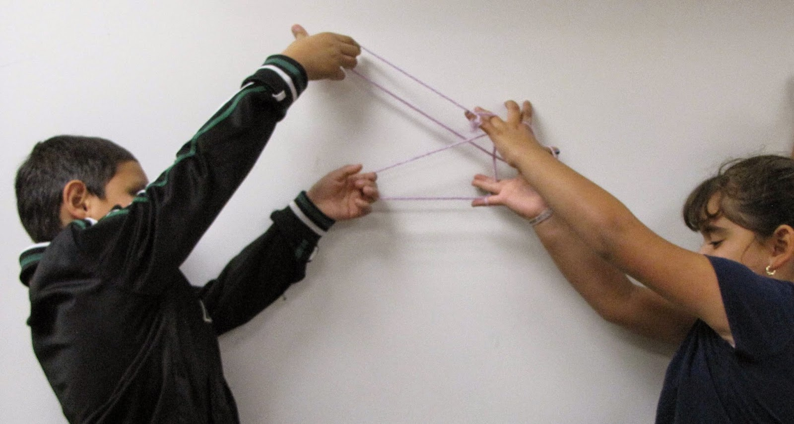 two students show a figure they invented