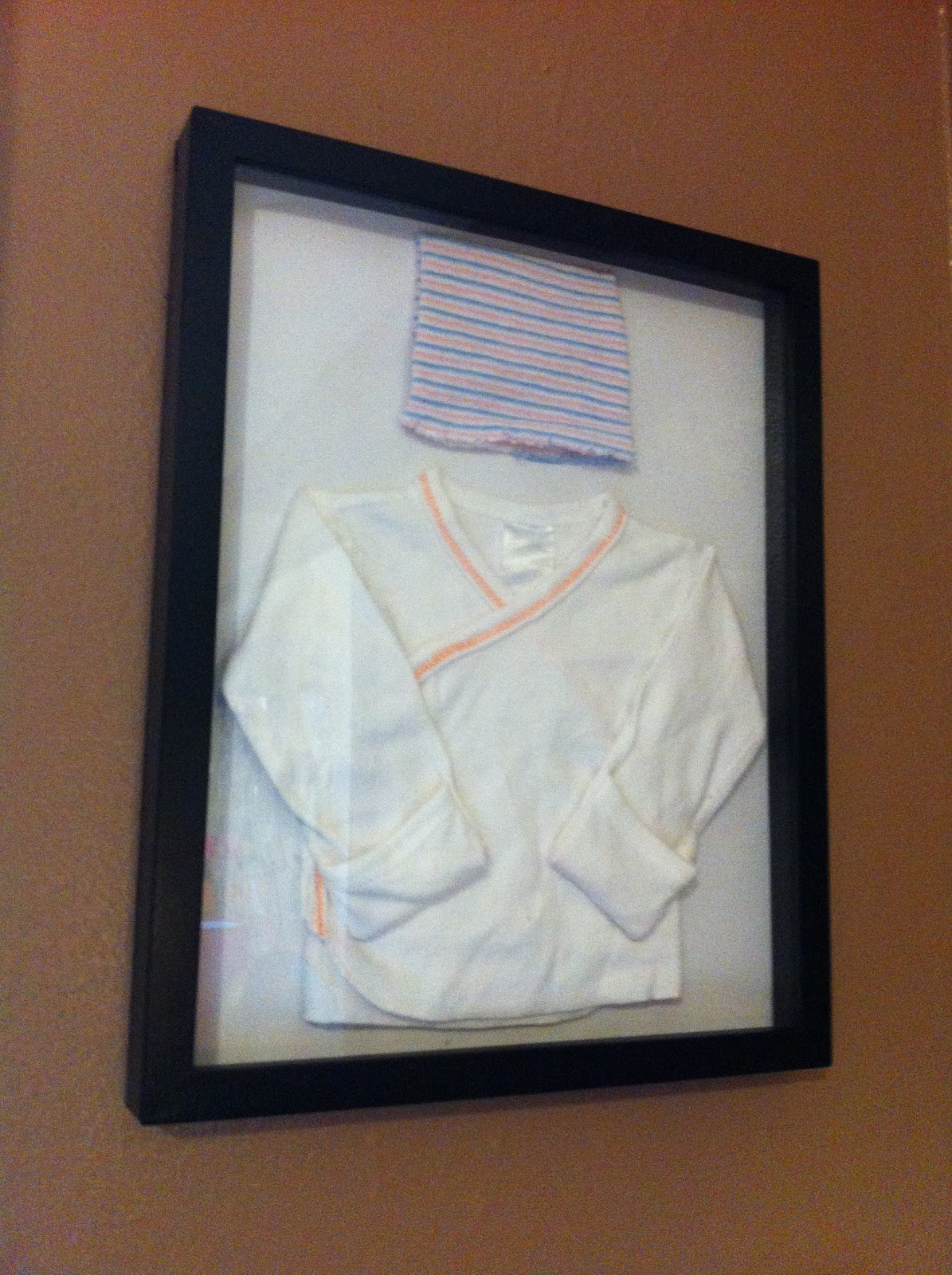 Domesticated me how to display baby clothes shadow box tutorial