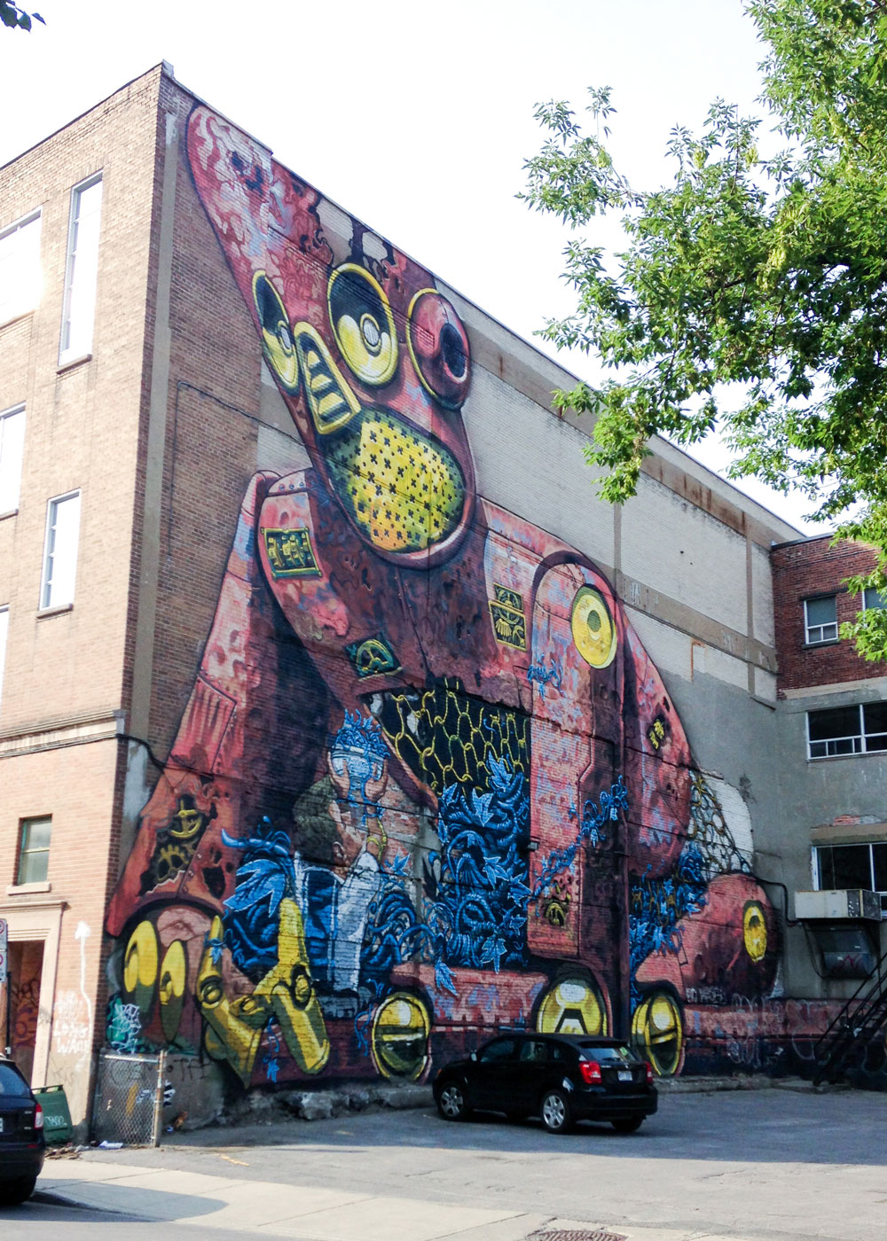 Montreal street art mural by Italian painter Pixel Pancho