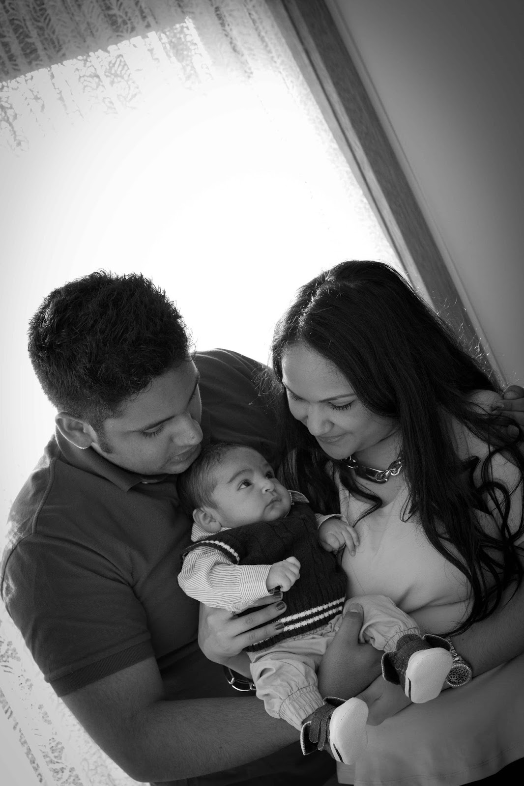 Baby and parents black and white
